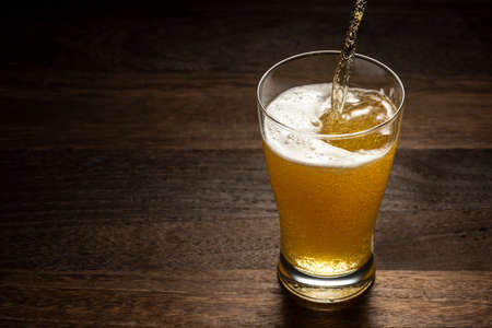 cold beer on wooden table
