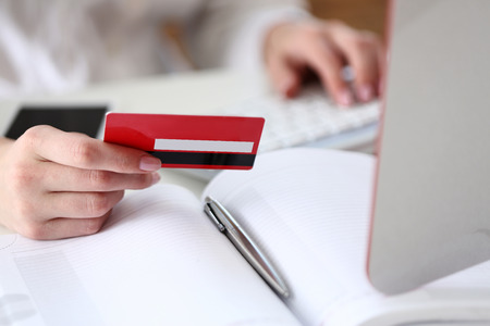 Female hands hold credit card, pressing buttons and making online purchase closeup. Anti-fraud and financial security, entering client discount program number, filling personal information concept