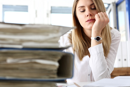 executor: Lot of work wait for tired and exhausted woman. Huge pile of document folders, headache and depression, irs, new problems, emotion expression, vacancy or holiday dream concept Stock Photo