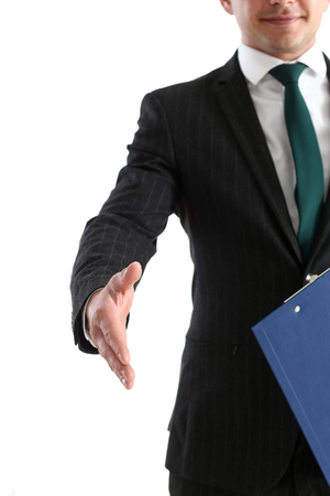 handclasp: Businessman offer hand to shake as hello closeup isolated on white. Serious business, friendly support service, excellent prospect, introduction or thanks gesture, gratitude, invite to participate concept Stock Photo