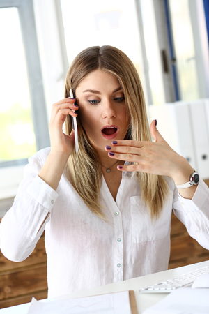 Beautiful blonde thoughtful businesswoman talk cellphone in office portrait. White collar busy life style, electronic device store, online shop, intrigue, fail, surprised amazed grimace concept