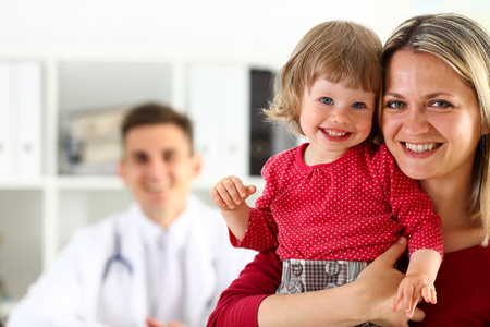 Little child with mother at pediatrician reception. Physical exam, cute infant portrait, baby aid, healthy lifestyle, ward round, child sickness, clinic test, high quality and trust concept Stok Fotoğraf - 80434224
