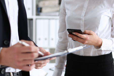 The concept of the development of technologies of double phased verification when besides signing the personal signature in the document it is necessary to assure the digital version via a smartphone Stock Photo