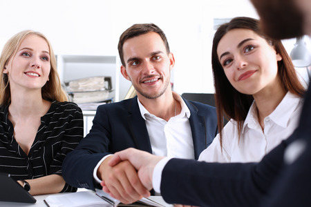 Greup business people shake hands as hello in office closeup. Friend welcome, introduction, greet or thanks gesture, product advertisement, partnership approval, arm, strike a bargain on deal concept