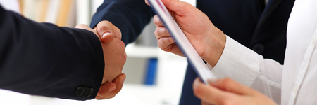handclasp: Man in suit shake hand as hello in office closeup. Friend welcome, mediation offer, positive introduction, greet or thanks gesture, summit participate approval, motivation, strike arm bargain concept