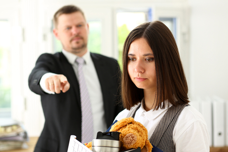 Angry yelling boss point arm to exit dismissing sad worker with stuff box portrait. Bad news, pack and carry belongings hopeless, human resources, staff reduction, hr get upset, give sack concept Stock Photo
