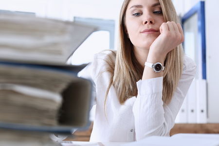 Lot of work wait for tired and exhausted woman. Huge pile of document folders, headache and depression, irs, new problems, emotion expression, vacancy or holiday dream concept Stock Photo