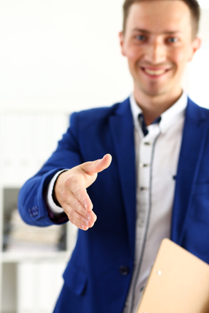 Businessman offer hand to shake as hello in office closeup. Serious business, friendly support service, excellent prospect, introduction or thanks gesture, gratitude, invite to participate concept
