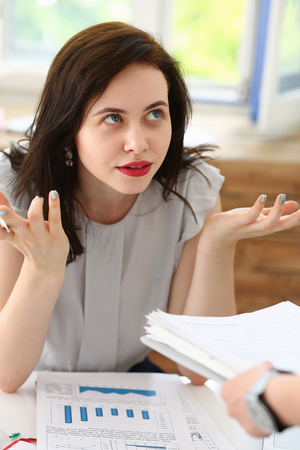 executor: Woman business annoyed at confusion confusion pulling her hands from a lot of paper work does not understand how you can bring as many documents