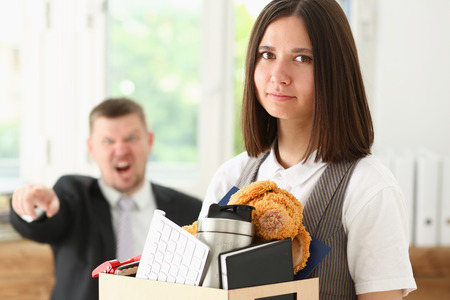 Angry yelling boss point arm to exit dismissing sad worker with stuff box portrait. Bad news, pack and carry belongings hopeless, human resources, staff reduction, hr get upset, give sack concept Archivio Fotografico