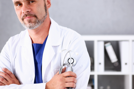 Male medicine doctor arms crossed on his chest in office. Medic store, physical and patient disease prevention, er consultant body, 911, profession, pulse measure, healthy lifestyle concept