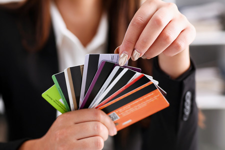 Female arm hold bunch of credit cards picking one closeup. Convenient set of funds, budget wallet deposit, wealth and effective investment, invest resources, income profit concept Reklamní fotografie - 87379564