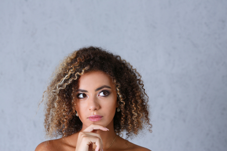 Beautiful black woman portrait. Looks upwards to the right Stock fotó