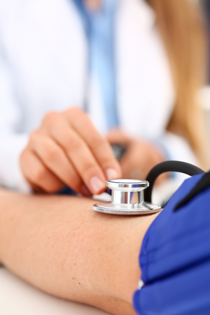 Female doctor arms make medic procedure closeup 写真素材