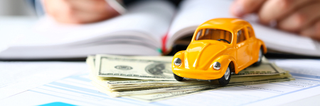 Unrecognizable yellow car on selling documents
