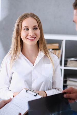 Female doctor arm hold silver pen filling patient complaints