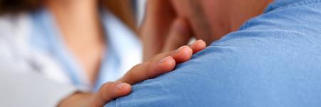 Friendly female doctor hold patient shoulder