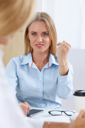 Angry yelling boss point arm to exit dismissing Stock Photo