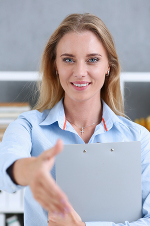 Businesswoman offer hand to shake as hello in office