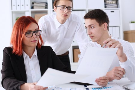 Group people sit in office deliberate on problem Stock Photo