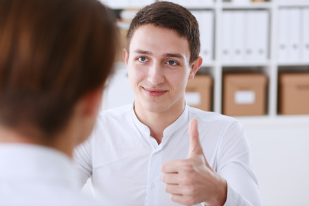 Male businessman showing ok or confirm sign Stock Photo