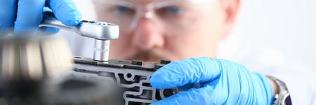 Repairman of a car-care center on repair of automatic transmissi