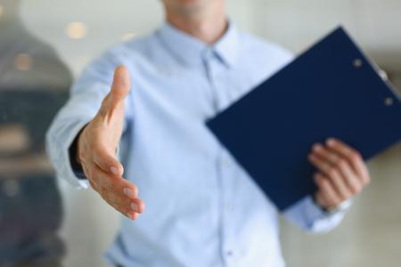 Businessman offer hand to shake as hello in office Reklamní fotografie - 88758748