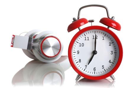 Red alarm clock with headphones isolated Stock Photo