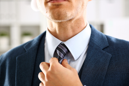 Male arm in blue suit set tie closeup