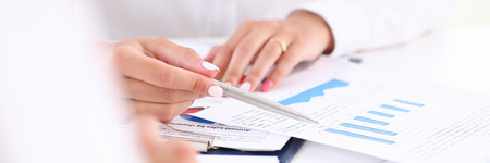 Businesswoman holding a silvery pen Stock Photo