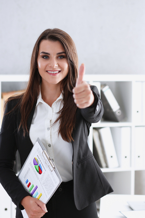 ambitious: Beautiful smiling woman showing ok or approval Stock Photo