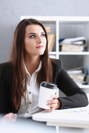 Business woman at workplace in office portrait