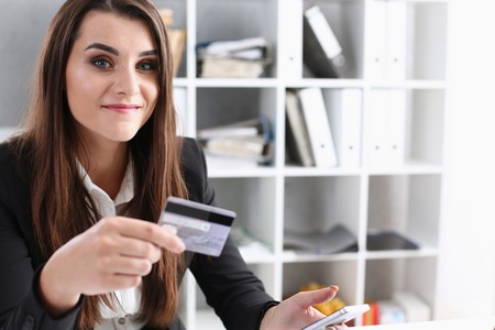 Business woman in the office holds plastic credit