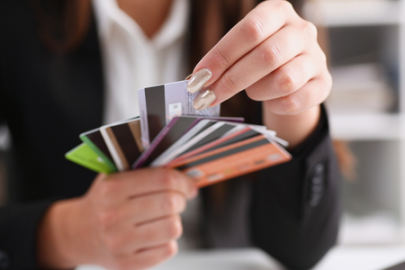 Female arm hold bunch of credit cards Stock Photo