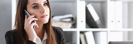 Beautiful brunett smiling businesswoman talk