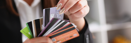 Female arm hold bunch of credit cards Banco de Imagens