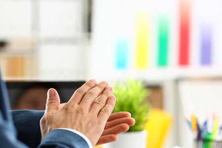 Man in suit clap his arms congrats Stock Photo