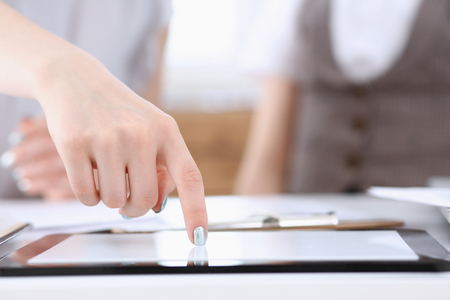 Businees woman toch on tablet pc finger display