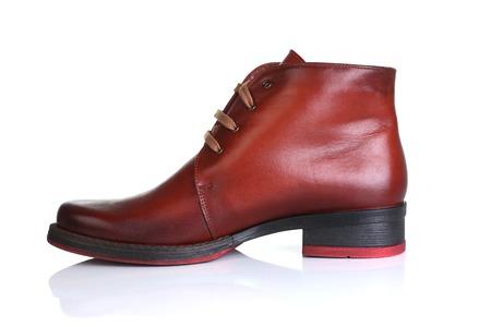 Orange red leather shoes men women Stock Photo