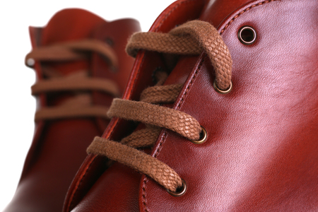 Orange red leather shoes men women Stock Photo