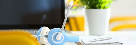 handsfree telephone: Empty remote office workplace with laptop and headset Stock Photo