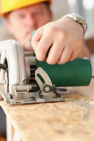 Worker using electric saw portrait Stock Photo