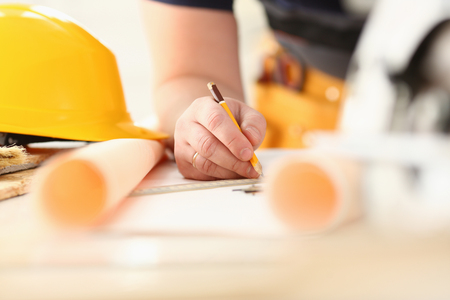 Arms of worker making structure plan Stock Photo