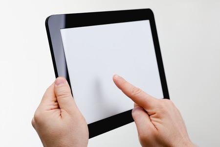 Man hoding black tablet frame in hand 写真素材