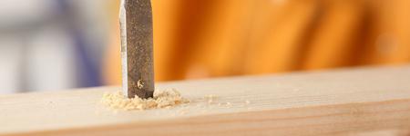 Flat drill bit make hole in wooden bar