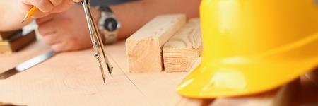 Arms of worker making structure plan Standard-Bild