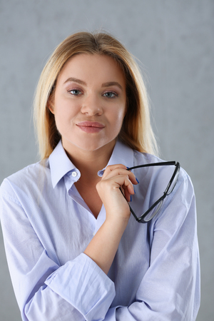 Portrait of a sexy woman in a man  shirt