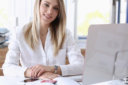 Beautiful smiling businesswoman portrait workplace