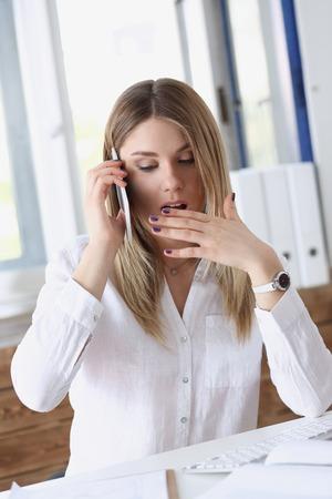 Beautiful blonde thoughtful businesswoman talk Banco de Imagens - 91608057