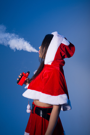 A Chinese woman in a Santa suit